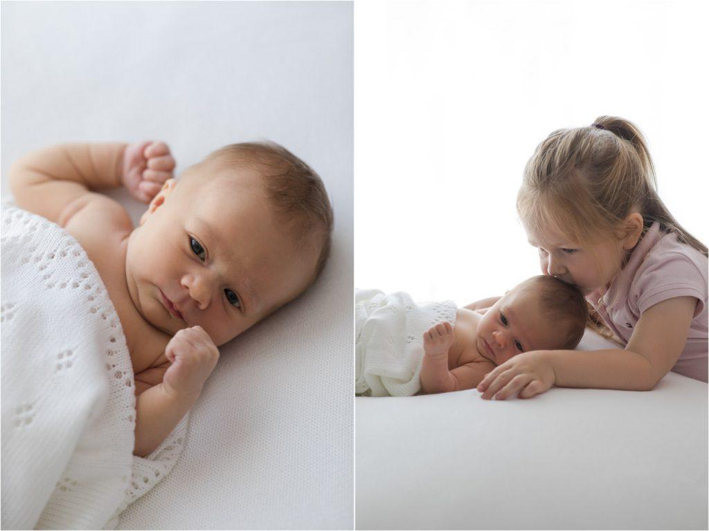 Geschwisterfoto mit Neugeborenem